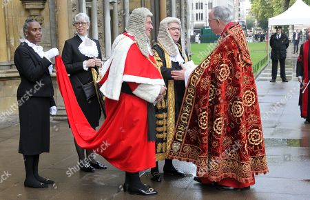 The Right Honourable The Lord Burnett of Maldon, Lord Chief Justice of England and Wales,(Red and White) and  The Right Honourable Robert Buckland QC MP, Lord Chancellor and Secretary of State for Justice,(Gold and Black) meet The Dean after the Service