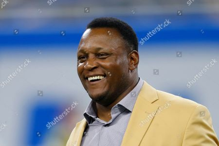Former Detroit Lions running back Barry Sanders, a member of the NFL Hall of Fame, appears during an NFL football game in Detroit, . The Lions named 39 players to its all-time team