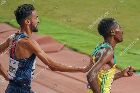 Stock Image of Djijali Bedrani (France) pushes Getnet Wale (Ethiopia), 3000 Metres Steeplechase Men Round 1, Heat 1, during the 2019 IAAF World Athletics Championships at Khalifa International Stadium, Doha