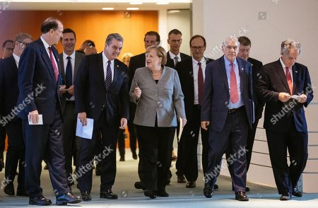 (front, L-R) President of the World Bank David Malpass, Director general of the World Trade Organization (WTO) Roberto Azevedo, German Chancellor Angela Merkel, Secretary-General of the Organization for Economic Co-operation and Development (OECD) Angel Gurria, Managing Director of the International Monetary Fund (IMF) David Lipton, (2-R) Director-General of the International Labour Organization (ILO) Guy Ryder arrive for a press conference at the German chancellery in Berlin, Germany, 01 October 2019. German Chancellor Merkel had a conversation with the chairmen of international economic and financial organizations.
