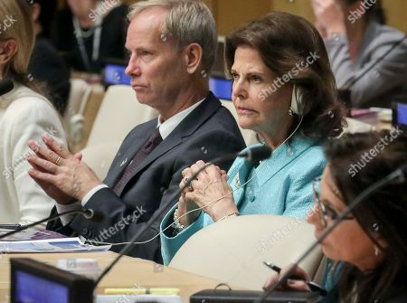 Queen Silvia of Sweden, center, founder of the World Childhood Foundation, and Sweden's United Nations Ambassador Olof Skoog, left, listen during a high level U.N. meeting on child online safety report from the Broadband Commission for Sustainable Development, at U.N. headquarters
