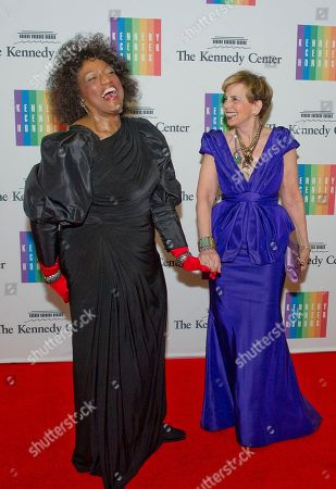 Jessye Norman, left, and Adrienne Arsht, right, share a laugh as they arrive for the formal Artist's Dinner honoring the recipients