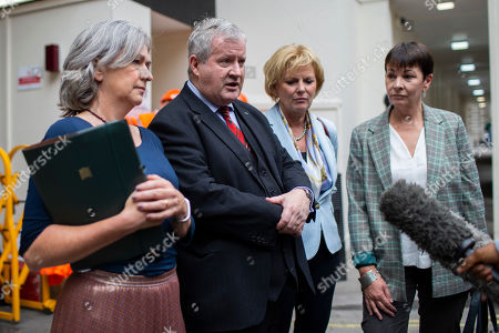 MP for Dwyfor and Meirionnydd Liz Saville-Roberts, SNP Leader Ian Blackford, Leader of Change UK Anna Soubry and Green Party Co-Leader Caroline Lucas talk to the media as they arrive at Portcullis House ahead of a meeting of opposition parties.