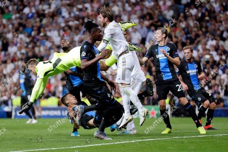 Brugge's goalkeeper Simon Mignolet is airborne as he goes for the ball during the Champions League group A soccer match between Real Madrid and Club Brugge, at the Santiago Bernabeu stadium in Madrid, Tuesday, Oct.1, 2019