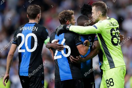 Brugge's Hans Vanaken, Mats Rits and goalkeeper Simon Mignolet celebrate their side 2-2 draw at the end of the Champions League group A soccer match between Real Madrid and Club Brugge, at the Santiago Bernabeu stadium in Madrid, Tuesday, Oct.1, 2019