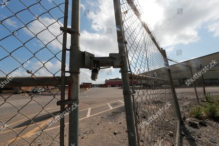 Locked gates are seen outside the closed Bayou Steel Group steel mill in LaPlace, La., . The Louisiana mill unexpectedly laid off 376 employees and says the factory will shut down in November