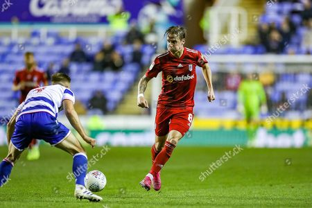Fulham midfielder Stefan Johansen (8) puts the ball through during the EFL Sky Bet Championship match between Reading and Fulham at the Madejski Stadium, Reading