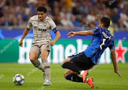 Stock Image of Shakhtar's Taison, left, and Atalanta's Jose Luis Palomino challenge for the ball during the Champions League group C soccer match between Atalanta and Shakhtar Donetsk at the San Siro stadium in Milan, Italy