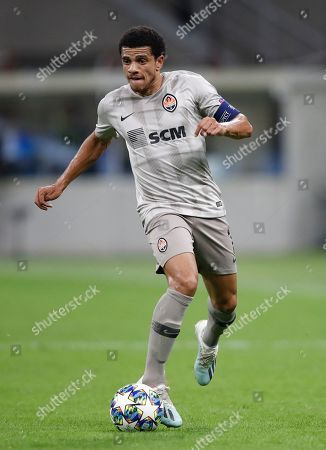 Stock Picture of Shakhtar's Taison challenges for the ball during the Champions League group C soccer match between Atalanta and Shakhtar Donetsk at the San Siro stadium in Milan, Italy