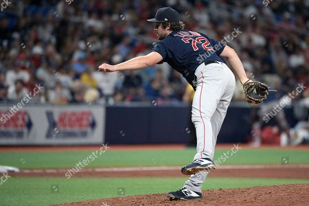 Stock Photo of Boston Red Sox relief pitcher Josh Taylor (72) follows through on a pitch during the seventh inning of a baseball game against the Tampa Bay Rays, in St. Petersburg, Fla