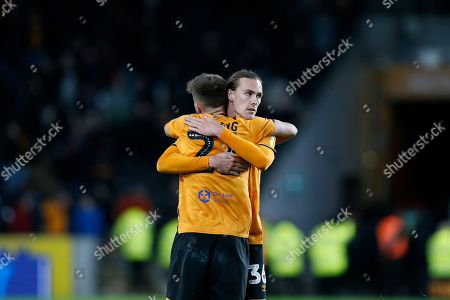 Josh Magennis of Hull City and Jackson Irvine of Hull City embrace after winning the EFL Sky Bet Championship match between Hull City and Sheffield Wednesday at the KCOM Stadium, Kingston upon Hull