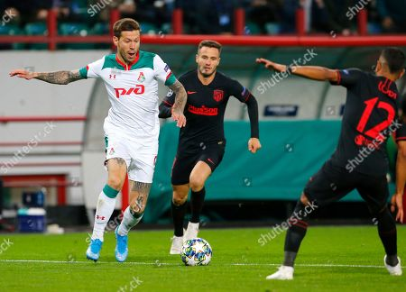 Lokomotiv's Fyodor Smolov, left, fights for the ball with Atletico Madrid's Renan Lodi during the Champions League Group D soccer match between Lokomotiv Moscow and Atletico Madrid at the Lokomotiv Stadium in Moscow, Russia