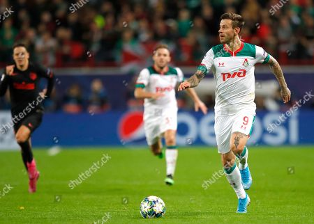 Lokomotiv's Fyodor Smolov, right, controls the ball during the Champions League Group D soccer match between Lokomotiv Moscow and Atletico Madrid at the Lokomotiv Stadium in Moscow, Russia