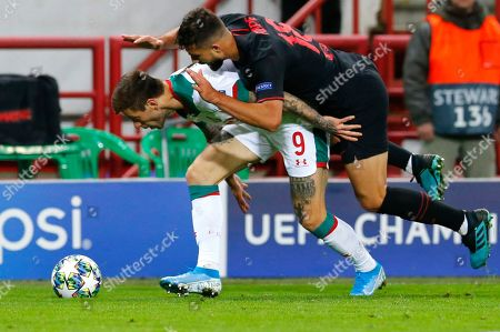 Lokomotiv's Jefferson Farfan, left, fights for the ball with Atletico Madrid's Felipe during the Champions League Group D soccer match between Lokomotiv Moscow and Atletico Madrid at the Lokomotiv Stadium in Moscow, Russia