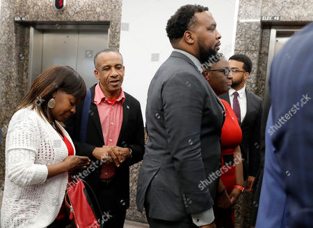 Bertrum Jean, Lee Merritt, Allison Jean. Bertrum Jean, second from left, attorney Lee Merritt, foreground, and Allison Jean, second from right, along with others arrive back at the Frank Crowley Courts Building for the sentencing phase in the trial of fired Dallas police officer Amber Guyger, in Dallas. Guyger, who said she fatally shot her unarmed, black neighbor Botham Jean after mistaking his apartment for her own was found guilty of murder by a jury earlier on Tuesday