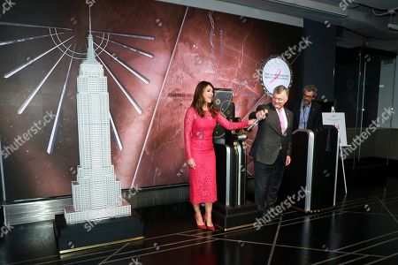 Elizabeth Hurley and William P. Lauder participates in the lighting of the Empire State Building in honor of The Estée Lauder Companies' 2019 Breast Cancer Campaign, in New York