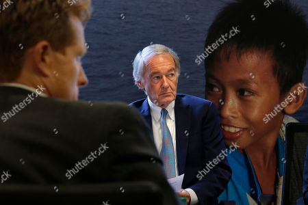 Joseph Kennedy III, Edward Markey. U.S. Rep. Joseph Kennedy III, D-Mass., left, and U.S. Sen. Edward Markey, D-Mass., center, listen during a roundtable discussion, in Boston, on the impact of a cap on refugee admissions to the U.S. for fiscal 2020. Massachusetts refugee resettlement agencies are urging the Trump administration to raise the admissions cap it has proposed decreasing to historically low levels