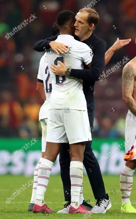 Paris Saint Germain's Presnel Kimpembe (L) and head coach Thomas Tuchel (R) celebrate after winning the UEFA Champions League group A match between Galatasaray and Paris Saint Germain in Istanbul, Turkey 01 October 2019.