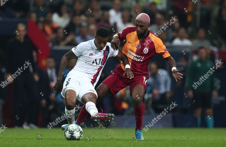 Paris Saint Germain's Kimpembe Presnel  (L) in action against Galatasaray's Ryan Babel  (R) at UEFA Champions League group A match between Galatasaray and Paris Saint Germain in Istanbul, Turkey 01 October 2019.
