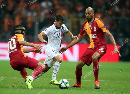 Paris Saint Germain's Juan Bernat (C) in action against Galatasaray's Younes Belhanda (L) and Steven Nzonzi (R) at UEFA Champions League group A match between Galatasaray and Paris Saint Germain in Istanbul, Turkey 01 October 2019.
