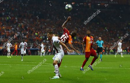 Paris Saint Germain's Thomas Meunier  (R) in action against Galatasaray's Marcao (R) at UEFA Champions League group A match between Galatasaray and Paris Saint Germain in Istanbul, Turkey 01 October 2019.