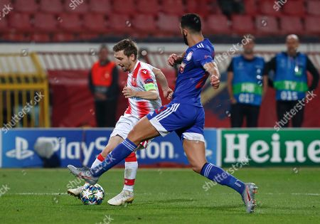 Red Star's Marko Marin, left, challenges for the ball with Olympiakos' Yassine Meriah during the Champions League group B soccer match between Red Star and Olympiacos, in Belgrade, Serbia, Tuesday, Oct.1, 2019