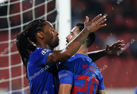 Olympiakos' Ruben Semedo, left, celebrates with Yassine Meriah after scoring his side's first goal during the Champions League group B soccer match between Red Star and Olympiacos, in Belgrade, Serbia, Tuesday, Oct.1, 2019