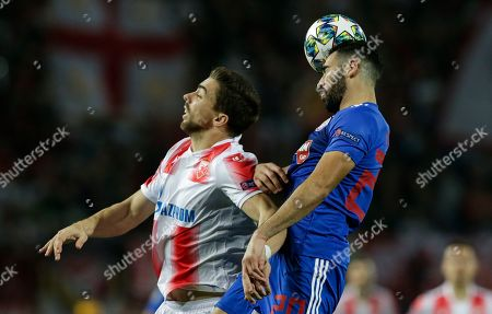 Olympiacos' Yassine Meriah (R) in action against Red Star?s Tomane (L) during the UEFA Champions League group B soccer match between Red Star Belgrade and Olympiacos in Belgrade, Serbia, 01 October 2019.