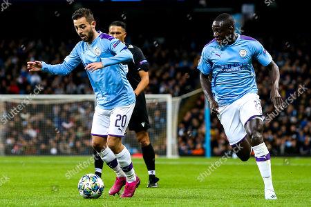 Bernardo Silva of Manchester City and Benjamin Mendy of Manchester City attack