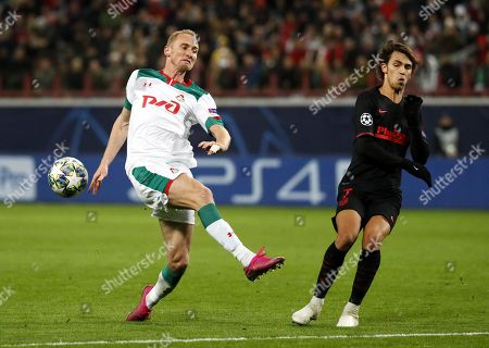 Stock Picture of Benedikt Hoewedes (L) of Lokomotiv Moscow in action against Joao Felix of Atletico Madrid during the UEFA Champions League match between Lokomotiv Moscow and Atletico Madrid in Moscow, Russia, 01 October 2019.