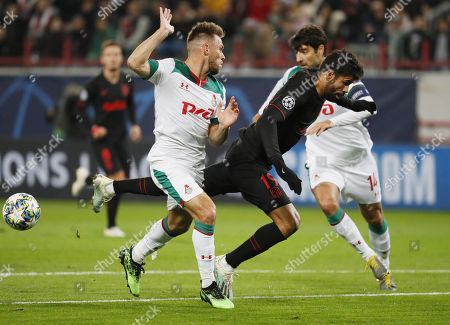 Maciej Rybus (L) of Lokomotiv Moscow in action against Diego Costa of Atletico Madrid during the UEFA Champions League match between Lokomotiv Moscow and Atletico Madrid in Moscow, Russia, 01 October 2019.