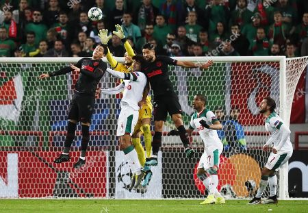 Goalkeeper Guilherme of Lokomotiv Moscow his teammate Vedran Corluka, Atletico Madrid's Jose Maria Gimenez (L) and Felipe (R) jump for the ball during the UEFA Champions League match between Lokomotiv Moscow and Atletico Madrid in Moscow, Russia, 01 October 2019.