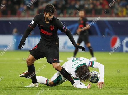 Grzegorz Krychowiak (R) of Lokomotiv Moscow in action against Diego Costa of Atletico Madrid during the UEFA Champions League match between Lokomotiv Moscow and Atletico Madrid in Moscow, Russia, 01 October 2019.