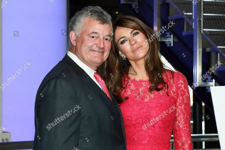 Elizabeth Hurley, William P. Lauder. Actress Elizabeth Hurley, right, and William P. Lauder participates in the lighting of the Empire State Building in honor of The Estée Lauder Companies' 2019 Breast Cancer Campaign, in New York
