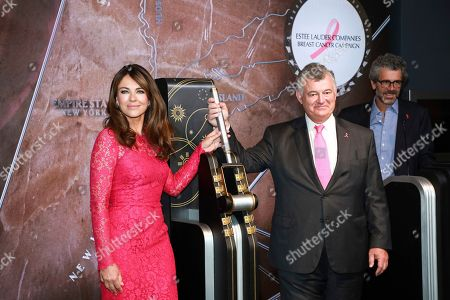 Elizabeth Hurley, William P. Lauder. Actress Elizabeth Hurley, left, and William P. Lauder participate in the lighting of the Empire State Building in honor of The Estée Lauder Companies' 2019 Breast Cancer Campaign, in New York