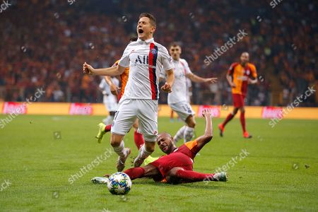 PSG's Ander Herrera, left, is tackled by Galatasaray's Marcao during the Champions League group A soccer match between Galatasaray and PSG in Istanbul