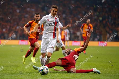 Stock Image of PSG's Ander Herrera, left, is tackled by Galatasaray's Marcao during the Champions League group A soccer match between Galatasaray and PSG in Istanbul
