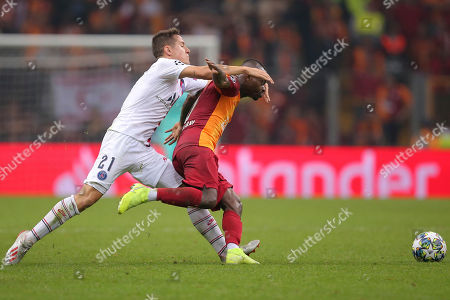 PSG's Ander Herrera, left, and Galatasaray's Jean Michael Seri compete for the ball during the Champions League group A soccer match between Galatasaray and PSG in Istanbul