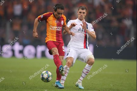 Stock Photo of Galatasaray's Ahmet Yilmaz Calik, left, and PSG's Thomas Meunier vie for the ball during the Champions League group A soccer match between Galatasaray and PSG in Istanbul