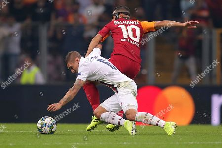PSG's Marco Verratti, left, and Galatasaray's Younes Belhanda vie for the ball during the Champions League group A soccer match between Galatasaray and PSG in Istanbul