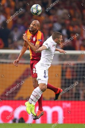 Galatasaray's Steven Nzonzi, left, and PSG's Marco Verratti go for a header during the Champions League group A soccer match between Galatasaray and PSG in Istanbul