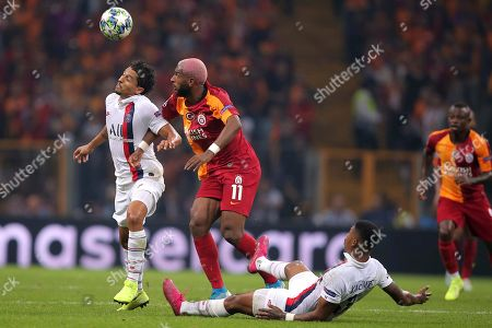 From left, PSG's Marquinhos, left, Galatasaray's Ryan Babel, and PSG's Presnel Kimpembe compete for the ball during the Champions League group A soccer match between Galatasaray and PSG in Istanbul