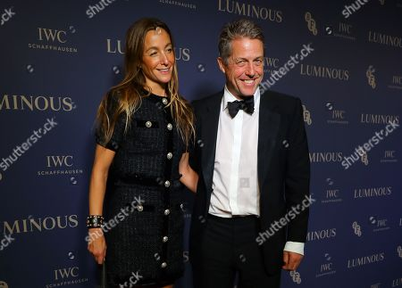 Stock Image of Hugh Grant (R) and his wife Anna Elisabet Eberstein (L) arrive at Luminous BFI Fundraising Gala at the Roundhouse in London, Britain, 01 October 2019. The event aims to raise funds for the BFI's educational work to ensure young people from all backgrounds have the chance to access training and resources, and to open up opportunities to work in the film industry.