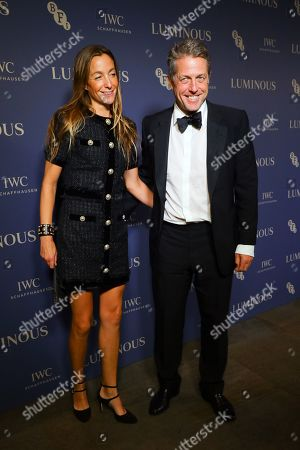 Hugh Grant (R) and his wife Anna Elisabet Eberstein (L) arrive at Luminous BFI Fundraising Gala at the Roundhouse in London, Britain, 01 October 2019. The event aims to raise funds for the BFI's educational work to ensure young people from all backgrounds have the chance to access training and resources, and to open up opportunities to work in the film industry.