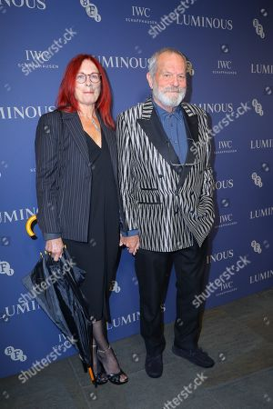 British actor Terry Gillam (R) and Maggie Weston arrive at Luminous BFI Fundraising Gala at the Roundhouse in London, Britain, 01 October 2019. The event aims to raise funds for the BFI's educational work to ensure young people from all backgrounds have the chance to access training and resources, and to open up opportunities to work in the film industry.