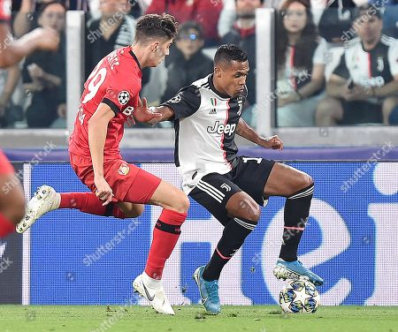 Stock Picture of Juventus' Alex Sandro (R) and Leverkusen's Kai Havertz in action during the UEFA Champions League group D soccer match between Juventus FC and Bayer Leverkusen at the Allianz Stadium in Turin, Italy, 01 October 2019.