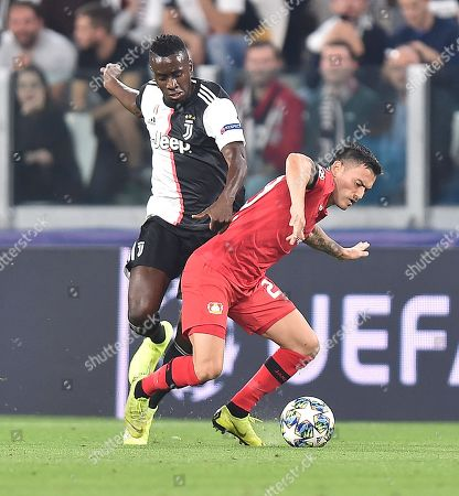 Stock Image of Juventus' Blaise Matuidi (L) and Leverkusen's Charles Aranguiz in action during the UEFA Champions League group D soccer match between Juventus FC and Bayer Leverkusen at the Allianz Stadium in Turin, Italy, 01 October 2019.
