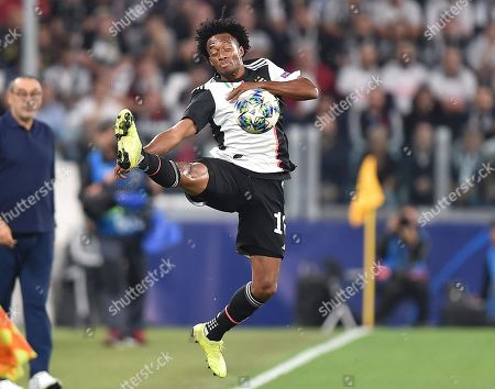 Juventus' Juan Cuadrado in action during the UEFA Champions League group D soccer match between Juventus FC and Bayer Leverkusen at the Allianz Stadium in Turin, Italy, 01 October 2019.
