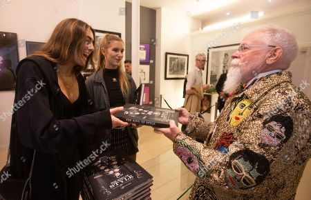 Stock Picture of Box Galleries and Juliens Auctions today celebrated the unique book signing event with Michael Bush, and his 'The King of Style: Dressing Michael Jackson' book. Michael JacksonÕs iconic sequined glove, worn during the Jackson Triumph Tour in 1981, and his custom velvet jacket, worn during Elizabeth TaylorÕs 65 th Birthday and 50 th Cannes Film Festival in 1997, were featured on show in London for their only appearance before their New York auction later in the month. The estimate for the Glove is $100,00-$200,000 and the Jacket is estimated at $20,000-$40,000.