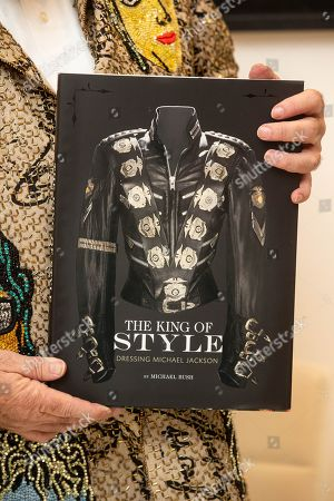 Box Galleries and Juliens Auctions today celebrated the unique book signing event with Michael Bush, and his 'The King of Style: Dressing Michael Jackson' book. Michael JacksonÕs iconic sequined glove, worn during the Jackson Triumph Tour in 1981, and his custom velvet jacket, worn during Elizabeth TaylorÕs 65 th Birthday and 50 th Cannes Film Festival in 1997, were featured on show in London for their only appearance before their New York auction later in the month. The estimate for the Glove is $100,00-$200,000 and the Jacket is estimated at $20,000-$40,000.